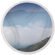 Scenic View Of Fog Over Mountains Round Beach Towel