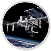 Space Station In Orbit Around Earth Round Beach Towel by Leonello Calvetti