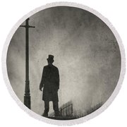Victorian Man Standing Next To An Illuminated Gas Lamp Round Beach Towel