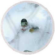 A Man Skiing In Powder Near South Lake Round Beach Towel