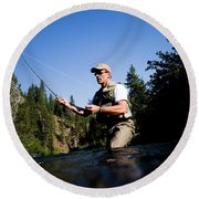 A Fly-fisherman In The Truckee River Round Beach Towel