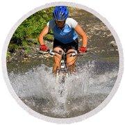 A Woman Mountain Bikes Along Trail 401 Round Beach Towel