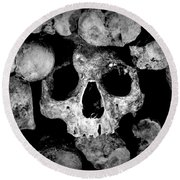 Altered Image Of Skulls And Bones In The Catacombs Of Paris France Round Beach Towel