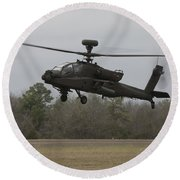 An Ah-64 Apache Helicopter In Midair Round Beach Towel