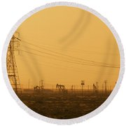 California Oil Field Under Amber Sky Round Beach Towel