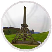 Replica Of Wooden Trebuchet And The Ruins Of The Urquhart Castle Round Beach Towel