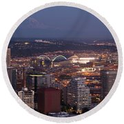 Seattle Skyline With Mount Rainier And Downtown City Lights Round Beach Towel