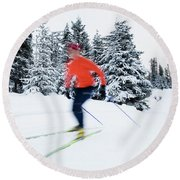 A Young Woman Cross-country Skiing Round Beach Towel