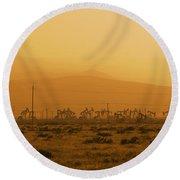 California Oil Field Under Amber Sky Round Beach Towel