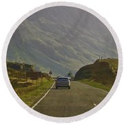 Cars And Other Vehicles On A Road In The Scottish Highlands Round Beach Towel