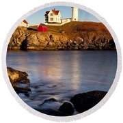Nubble Lighthouse Round Beach Towel by Brian Jannsen
