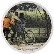 3 Young Children On A Cycle At The Side Of The Road Round Beach Towel