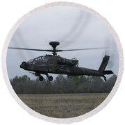 An Ah-64 Apache Helicopter In Midair Round Beach Towel