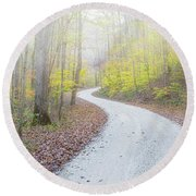 Road Passing Through A Forest Round Beach Towel
