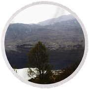 Trees On The Shore Of A Loch And Hills In The Scottish Highlands Round Beach Towel
