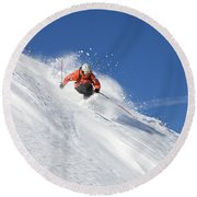A Young Man Skis Untracked Powder Round Beach Towel