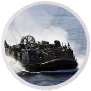 A Landing Craft Air Cushion Transits Round Beach Towel