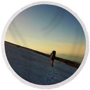 A Backpacker Crosses A Snowfield On Mt Round Beach Towel
