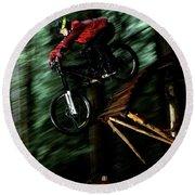 A Biker Rides His Mountain Bike Round Beach Towel