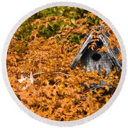 A Bird House Sits Empty In Fall Round Beach Towel