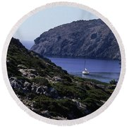 A Boat Sailing In The Valley Round Beach Towel