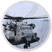 A Ch-53e Super Stallion Conducts Flight Round Beach Towel