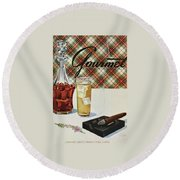 A Cigar In An Ashtray Beside A Drink And Decanter Round Beach Towel