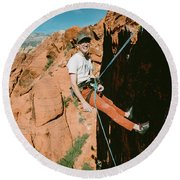 A Climber On Panty Wall In Red Rock Round Beach Towel