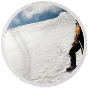 A Climber On The Glacier Of Cotopaxi Round Beach Towel