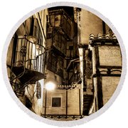 A Couple In A Little Restaurant In The Ancient City Of Albarracin Round Beach Towel
