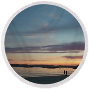 A Couple Walk Along The Shore Round Beach Towel