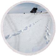 A Couple Walking In The Snow Round Beach Towel