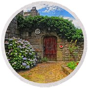 A Courtyard In Brittany France Round Beach Towel
