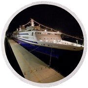 A Cruise Ship At Night Docked Round Beach Towel