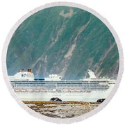 A Cruise Ship Passes By A Wolf Roaming Round Beach Towel