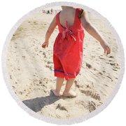 A Cute Little Hispanic Girl Wearing Round Beach Towel