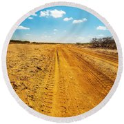 A Dirt Road In The Desert Round Beach Towel