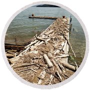 A Dock Covered With Driftwood Round Beach Towel