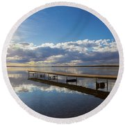 A Dock Leading Out Into The Lake At Round Beach Towel