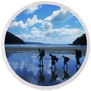 A Family Of Hikers Walks Round Beach Towel