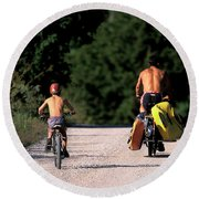 A Father And Son Ride Their Bikes To Go Round Beach Towel