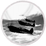 A Group Of P-40 Warhawks Fly Round Beach Towel