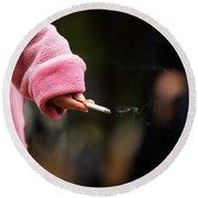 A Hand Holding A Cigarette Round Beach Towel