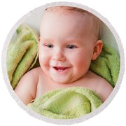 A Happy Baby Lying On Bed In Green Towel Round Beach Towel