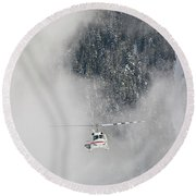 A Heli-ski Helicopter Flies Round Beach Towel