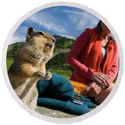 A Hiker Makes Friends With The Local Round Beach Towel