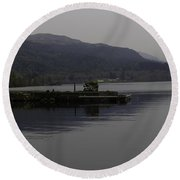 A Jetty Pushing Out Into The Waters Of Loch Ness In Scotland Round Beach Towel