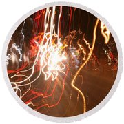 A Light Dance In Old Town Round Beach Towel