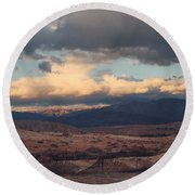 A Light In The Distance Round Beach Towel