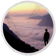 A Lone Hiker Above The Clouds Round Beach Towel